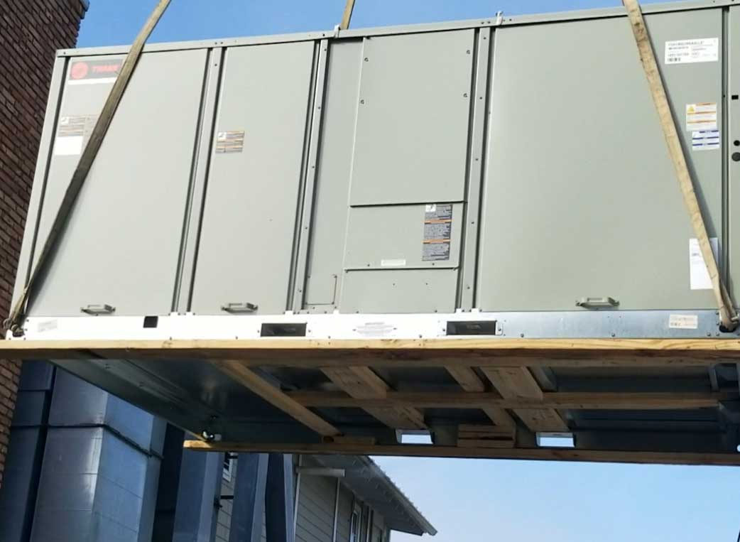 Large RoofTop AC Unit being moved into place