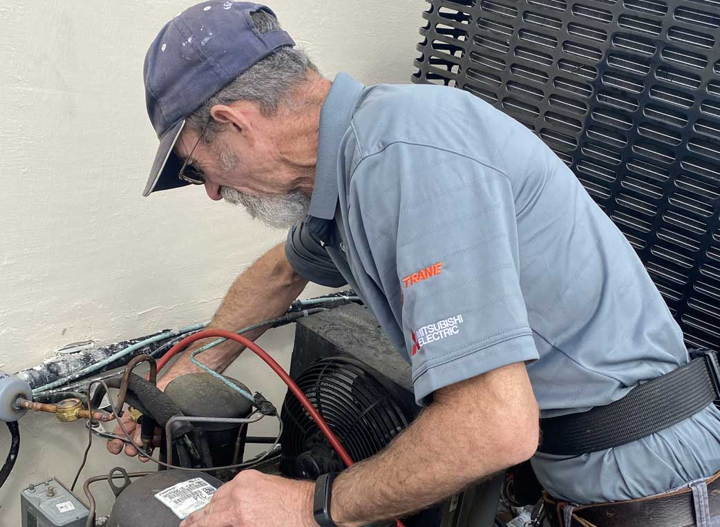 JefCo Air Conditioning Refrigeration Tech at work